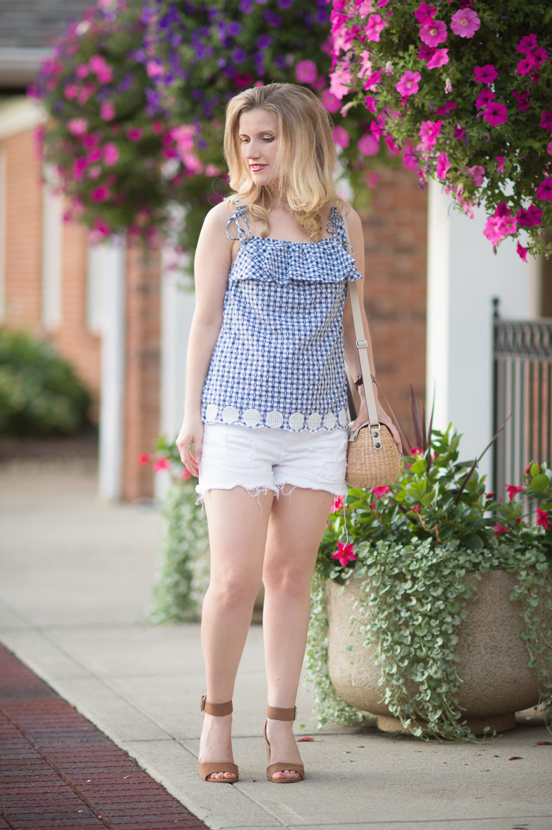 Petite Fashion and Style Blog | J. Crew Tie-shoulder ruffle top with eyelet trim | Express white destroyed denim cutoff shorts | Sea and Grass Tote | Steve Madden Gerard Sandals | Click to Read More...