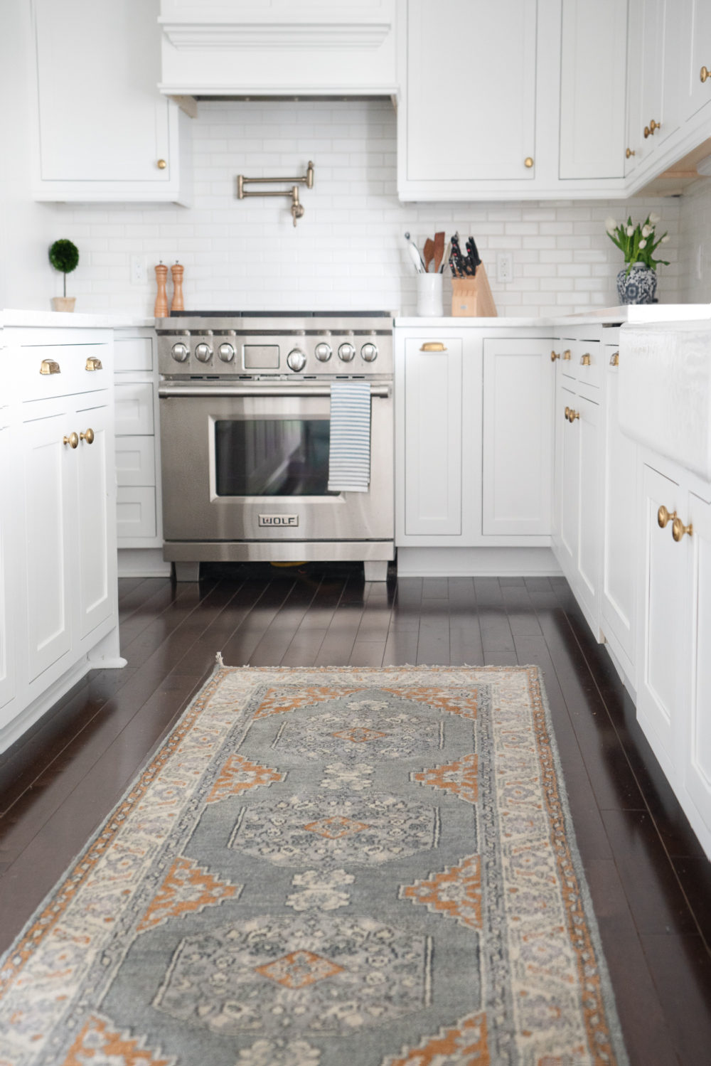 Petite Fashion Blog |White Kitchen | Inset Cabinets | From Overlay to Inset | Caitlin Wilson Rugs
