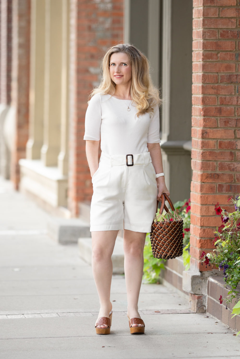Petite Fashion Blog | Ann Taylor Boatneck Sweater Tee | JOA Ivory belted shorts | Tory Burch Wedge Slides | Staud Beaded Moreau Bag