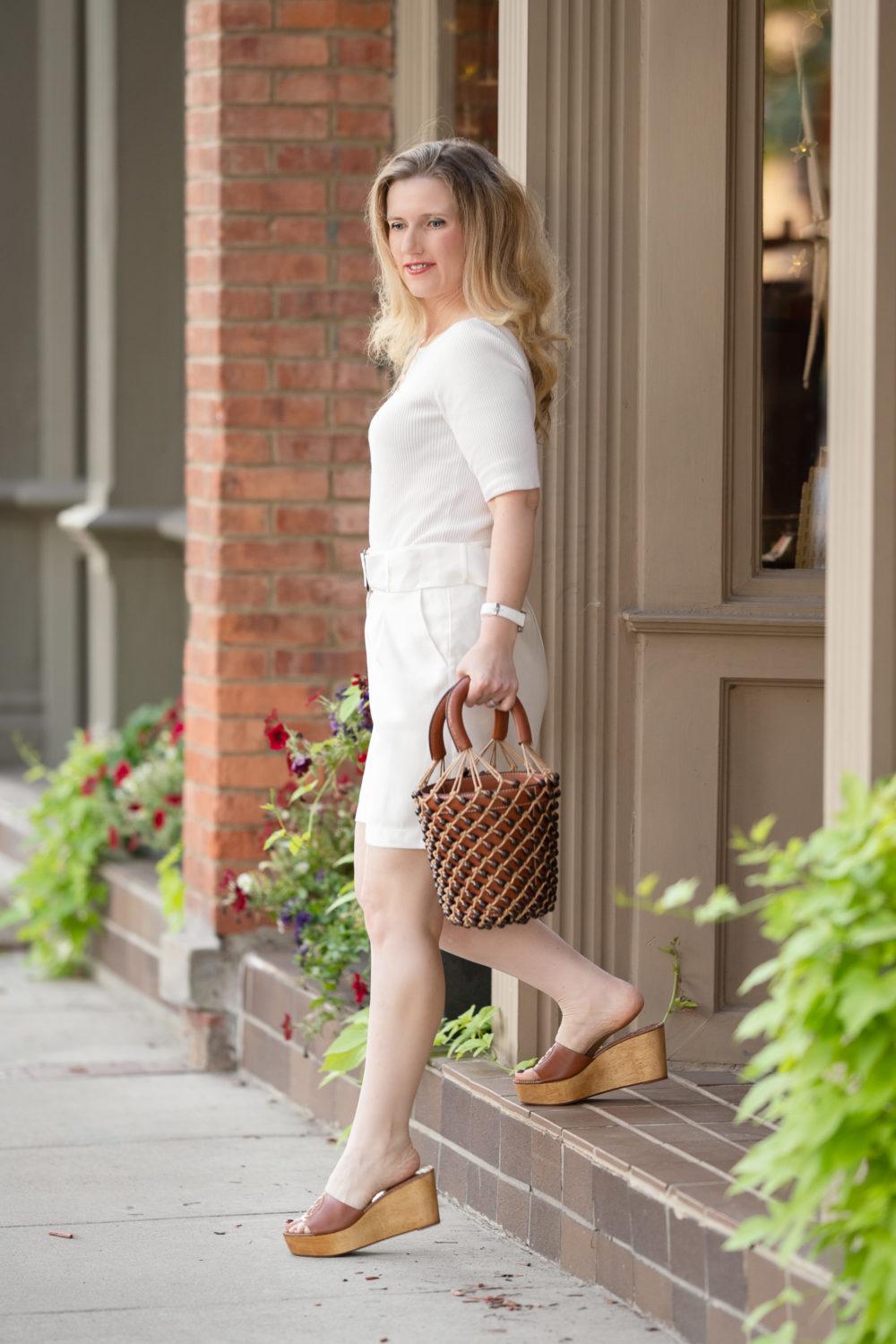 Petite Fashion Blog   Ann Taylor Boatneck Sweater Tee   JOA Ivory belted shorts   Tory Burch Wedge Slides   Staud Beaded Moreau Bag