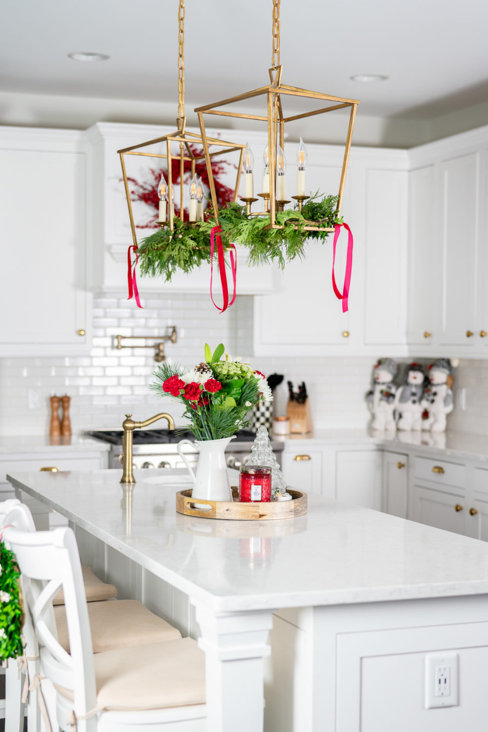 Petite Fashion Blog | Our Home for the Holidays | Christmas Decor | Flocked Christmas Tree | White Kitchen