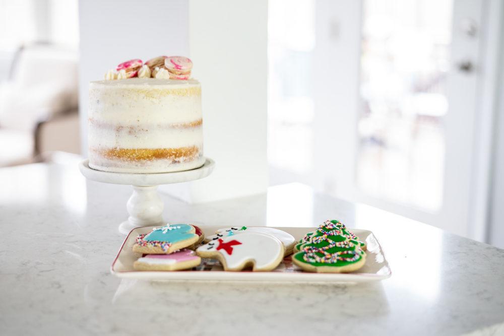 Petite Fashion Blog | Our Home for the Holidays | Christmas Decor | Flocked Christmas Tree | White Kitchen