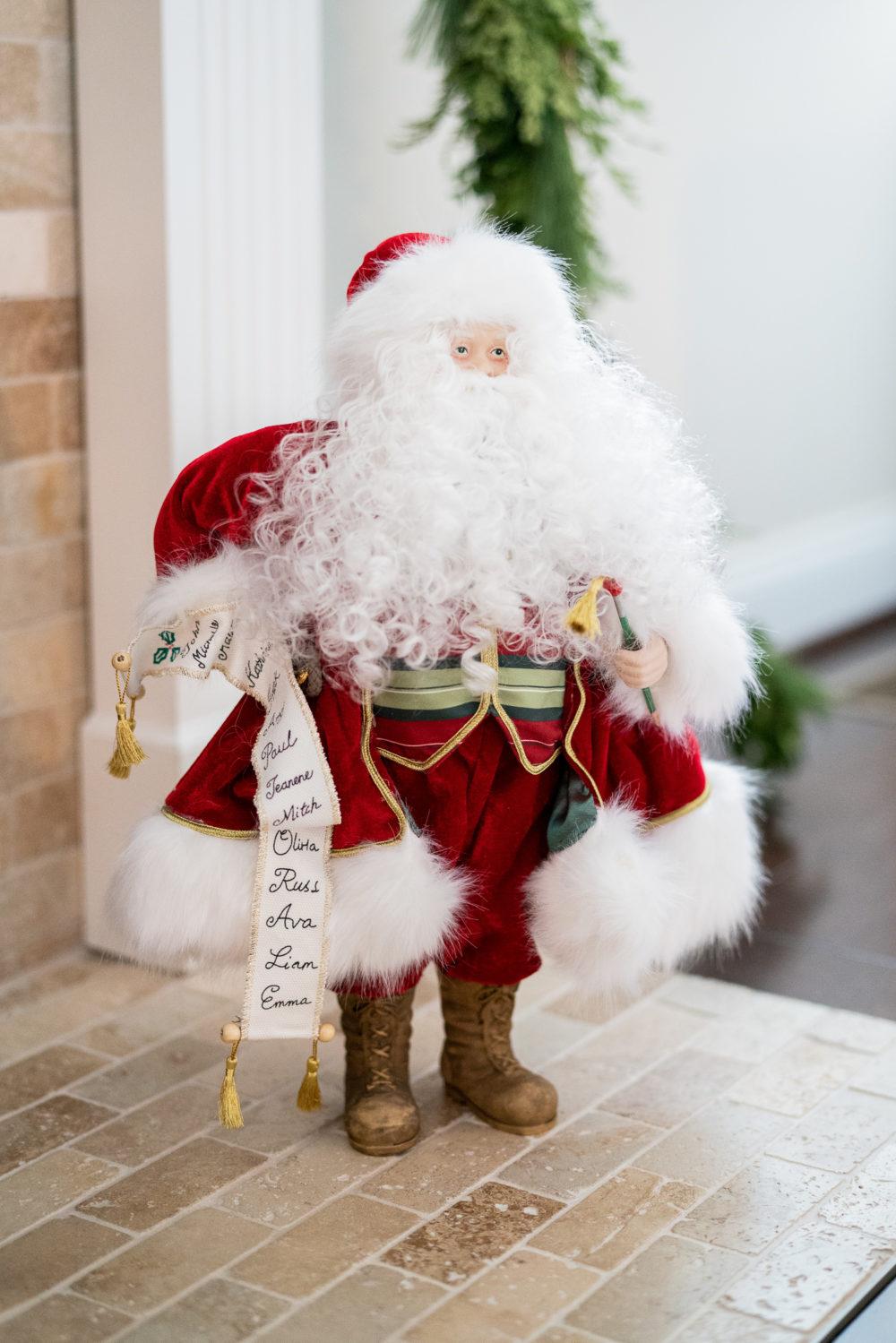Petite Fashion Blog | Our Home for the Holidays | Christmas Decor | Flocked Christmas Tree | Santa Statue